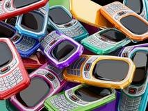 Teléfonos móviles coloreados multi del viejo estilo con el telclado numérico ilustración 3D Fotografía de archivo libre de regalías