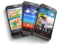 Teléfonos móviles en el fondo blanco Fotografía de archivo libre de regalías
