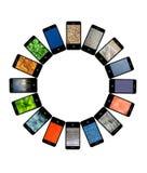 Teléfonos móviles modernos con diversas imágenes Imagen de archivo libre de regalías