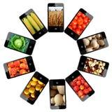 Teléfonos móviles modernos con diversas imágenes Imágenes de archivo libres de regalías