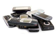 Teléfonos móviles viejos fotografía de archivo libre de regalías