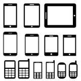 Teléfonos móviles y tabletas fijados Fotos de archivo libres de regalías