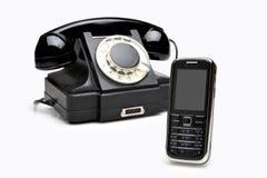 Teléfonos modernos y de la vendimia Imágenes de archivo libres de regalías