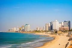 Tel Aviv beach and city, Israel. TEL AVIV ISRAEL November 2016: Tel Aviv beach coast with a view of Mediterranean sea and skyscrapers Royalty Free Stock Image