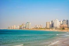 Tel Aviv beach and city, Israel. Tel Aviv Israel November 2016: Tel Aviv view of Mediterranean sea and skyscrapers Royalty Free Stock Images