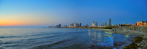 Tel Aviv Beach Panorama, Israel. A panoramic view of the coast as the sun sets on Tel Aviv, Israel Royalty Free Stock Image