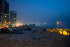 Tel-Aviv beach in the winter. TEL-AVIV, ISRAEL - JANUARY 18, 2018: View of the beach in a winter evening, with old Jaffa in the background. Tel-Aviv, Israel Royalty Free Stock Photography
