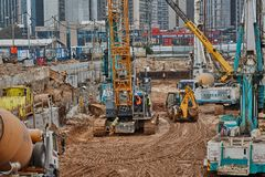 Tel Aviv - 10.06.2017: Construction site machinery and workers i. N Tel Aviv royalty free stock images