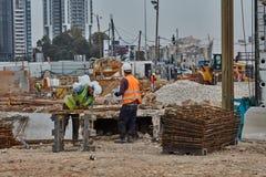 Tel Aviv - 10.06.2017: Construction workers in Tel Aviv cut fitt Royalty Free Stock Photography