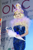 Tel Aviv ISRAEL - April 27, 2015: OMS Israel -Blonde girl in a blue dress with an umbrella with a chic hairstyle Royalty Free Stock Photography