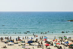 Summer at the Beach in Tel-Aviv. Tel-Aviv, Israel - August 18th, 2012: High angle view of the beach in Tel-Aviv, packed with people on a hot summer day Royalty Free Stock Image
