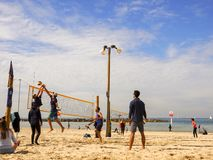 Tel Aviv, Israel - February 4, 2017: Group of young people playing volleyball on the beach Tel Baruch royalty free stock photos