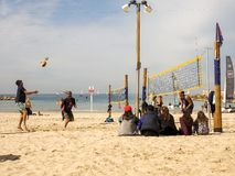 Tel Aviv, Israel - February 4, 2017: Group of young people playing volleyball on the beach Tel Baruch stock image