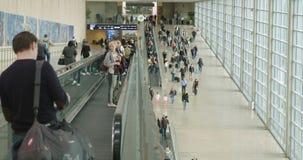 Tel Aviv, Israel - January 2018. People going through the large terminal halls. Tel Aviv, Israel - January 2018. Passengers going through the large terminal stock footage