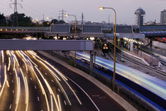 Dusk Traffic. Tel-Aviv, Israel - June 28th, 2011: Evening rush hour time at the Ayalon highway and Savidor train station in Tel-Aviv. The long exposure turns the Royalty Free Stock Photo