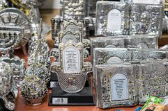 Silver Hamsa with Home blessing sale at Carmel Market, popular marketplace in Tel-Aviv. Israel. TEL-AVIV, ISRAEL - MAY 08, 2018: Silver Hamsa with Home blessing royalty free stock photo