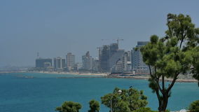 TEL AVIV, ISRAEL - 28 MAY 2017: Tel Aviv beach coast with a view of the sea and skyscrapers stock footage