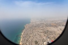 View of the Mediterranean Sea and the coast of Tel Aviv city from the window of a flying airplane, Tel Aviv in Israel. Tel Aviv, Israel, May 01, 2019 : View of royalty free stock image