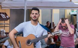 Undefined young guy play on guitar at old Jaffa Flea Market stock photos