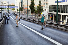 Skaters on a Bridge Royalty Free Stock Image