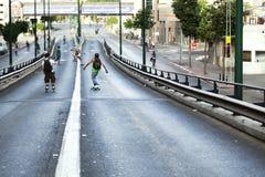 Skaters on a Bridge Royalty Free Stock Photos