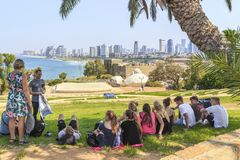 An aerial view of Tel Aviv from Glee Hill in Jaffa. TEL AVIV, ISRAEL - SEPTEMBER 17, 2017: A group of unidentified tourists look at the aerial city`s panorama stock photos