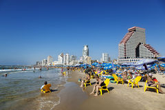 Tel Aviv Beach & Hotel Strip. Tel-Aviv, Israel - September 3rd, 2011: View looking north at the Tel-Aviv shoreline and hotels strip on a clear day; with its long Royalty Free Stock Photos