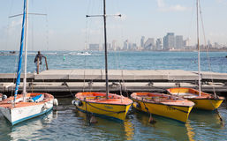 Tel Aviv - little harbor and yachts under old Jaffa and Tel Aviv in the backgound in the morning light Stock Photography