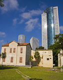 Tel-Aviv Old & New. Templar buildings in the Sharona colony on Kaplan Street versus the modern skyscraper - Tel Aviv, Israel royalty free stock photos
