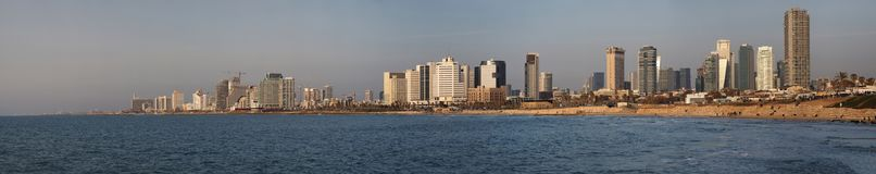 Tel Aviv panorama, high-rise buildings, skyscrapers along waterfront, blue sea, blue sky with thin clouds, Israel. Tel Aviv panorama, high-rise buildings Stock Photo