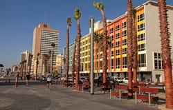 Tel Aviv Promenade, Israel. TEL AVIV, ISRAEL - SEPTEMBER 1, 2015: People on Tel Aviv beach promenade with modern hotels and colorful buildings in Tel Aviv Royalty Free Stock Photo