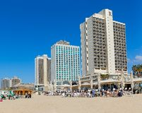 Tel Aviv riviera. TEL AVIV, ISRAEL - MARCH 1, 2014: Panorama of the beach, riviera, hotels and long promenade along skyline shot from the beach Royalty Free Stock Image