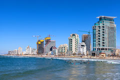 Tel Aviv`s coastline. With sea front hotels and buildings and people at the beach Stock Image