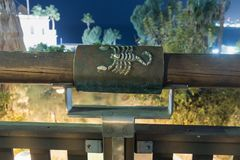 Sign of the zodiac Scorpio on the bridge of the Wishing Bridge in the brown light of a spotlight located on old city Yafo in Tel A. Tel Aviv-Yafo, Israel stock images