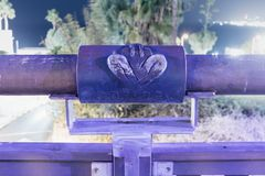 Sign of the zodiac Virgo on the bridge of the Wishing Bridge in the violet light of a spotlight located on old city Yafo in Tel Av. Tel Aviv-Yafo, Israel royalty free stock image