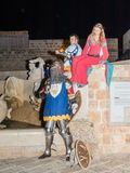 Members of the Knights of Jerusalem club - two knights and a lady dressed in traditional armor and costumes, posing for photograph. Tel Aviv-Yafo, Israel Stock Photo