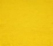 Tela amarilla superficial para el fondo Fotografía de archivo libre de regalías