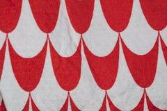 Tela blanca y roja hecha de las lanas, fondo fotografía de archivo