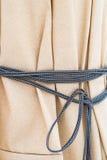 Tela con una cuerda Imagen de archivo libre de regalías