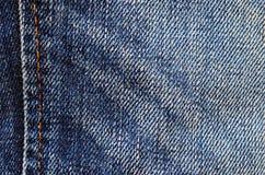 A tela das calças de brim Fundo, textura para o projeto Fotografia de Stock