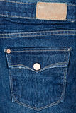Tela de calças de ganga com bolso e etiqueta Imagem de Stock Royalty Free