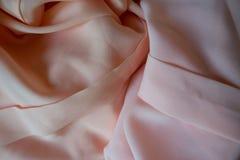 Tela de la gasa en rosa y colores en colores pastel del melocotón Fotografía de archivo libre de regalías