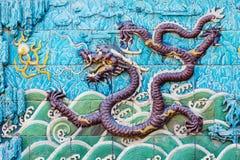 Tela de nove dragões do Pequim o palácio imperial fotografia de stock