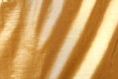 Tela de oro Fotos de archivo