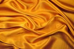 Tela del oro Imagenes de archivo