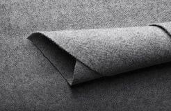 Tela del tweed, fondo gris de la materia textil de la raspa de arenque de las lanas Foto de archivo libre de regalías