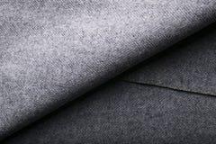 Tela del tweed, fondo gris de la materia textil de la raspa de arenque de las lanas Fotos de archivo libres de regalías