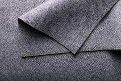 Tela del tweed, fondo gris de la materia textil de la raspa de arenque de las lanas Imagen de archivo libre de regalías