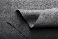 Tela del tweed, fondo gris de la materia textil de la raspa de arenque de las lanas Imagen de archivo