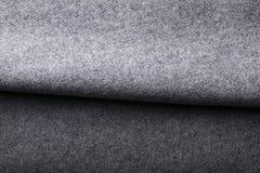 Tela del tweed, fondo gris de la materia textil de la raspa de arenque de las lanas Imágenes de archivo libres de regalías